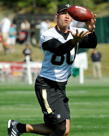 Tight end Jimmy Graham keeps his eye on the ball as he catches a pass during practice Saturday afternoon in White Sulphur Springs.
