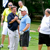 Amateur golfer David Carney, middle, is congratulated by his group's pro golfer, five time Open winner Brad Westfall, after scoring a double eagle on hole #2 as his partners (background L to R) John Brophy, Johnny Hutchins and Ray Chapman marvel at the scene Monday afternoon during the West Virginia Open Pro-Am. <br /> Brad Davis/The Register-Herald