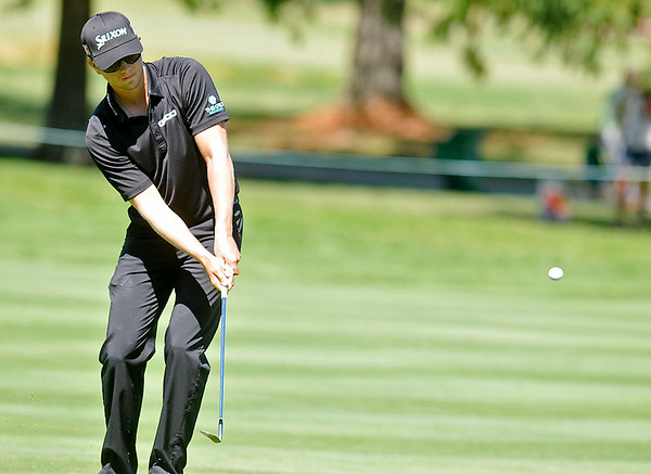 Chris Stroud chips from the fairway during the Greenbrier Classic Saturday in White Sulphur Springs.<br /> Brad Davis/The Register-Herald