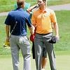 Chris Stroud, right, shakes hands with Billy Hurley III after finishing there round on the 9th hole during the second round of The Greenbrier Classic.<br /> Rick Barbero/The Register-Herald