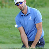 Cameron Tringale hits out of the trap on the 15th hole during the final round of The Greenbrier Classic.<br /> Rick Barbero/The Register-Herald
