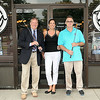 Register-Herald Editor Rick Kelly, left, Dish Owner and BNI sponsor Michelle Roiellini, center, and David Hunter, right, gear up for this weekend's event. F. Brian Ferguson/The Register-Herald