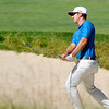 Kevin Chappell chips onto the green from a bunker during the Greenbrier Classic Saturday in White Sulphur Springs.<br /> Brad Davis/The Register-Herald
