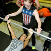 Shelly Walker, below, cranks out reps on the bench press as fellow athlete Amanda Gardner spots for her during a CrossFit session July 15 at L.A. East Fitness on Mountaineer Drive.<br /> Brad Davis/The Register-Herald