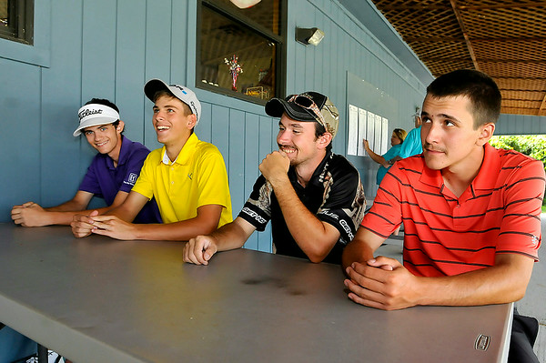 BNI Tournament participants (L to R) Brandon Keaton, Landon Perry, Todd Albaugh and Dakota McComas chat with the Register-Herald following their 2nd round Sunday afternoon at Grandview Country Club. Three of the four are Shady Spring High School alums while Keaton is entering his junior year. Perry, who is heading to WVU this year to be a part of a brand new golf program that will get started in 2015, aspires to one day play on the PGA Tour. Albaugh is off to Concord this year where he will play for their golf team. <br /> Brad Davis/The Register-Herald