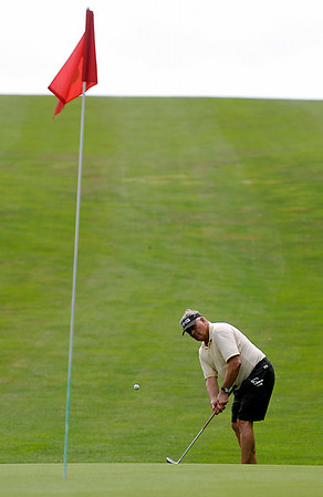 Welch resident Mike Vallo chips onto the green on the 16th hole at Grandview Country Club Saturday morning during the 34th annual BNI tournament.<br /> Brad Davis/The Register-Herald