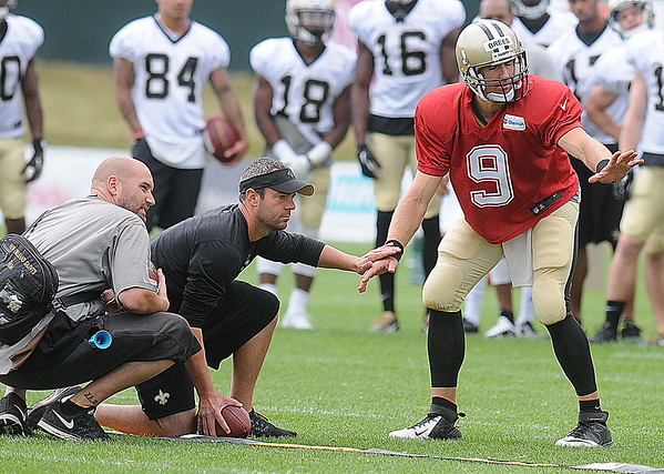 Drew Brees, running some pass plays during the New Orleans Saints fourth day of training camp on  at The Greenbrier Resort.<br /> Rick Barbero/The Register-Herald