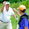 Oak Hill resident Randal Rosiek, left, shares a laugh as he gets a fist bump with group partner Aaron Kemlock on #17 during the second day of BNI tournament action Sunday afternoon at Brier Patch Golf Course.<br /> Brad Davis/The Register-Herald
