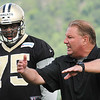 Tyrunn Walker, left, listen to Bill Johnson, defense line coach during the New Orleans Saints first day of training camp on the new practice fields at The Greenbrier Resort.<br /> Rick Barbero/The Register-Herald