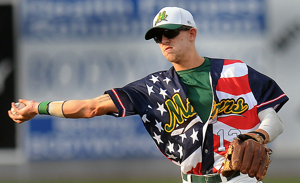 West Virginia Miners 2nd Baseman Ryan Perkins makes the throw to first for the out against Champion City during Thursday evening action at Linda K. Epling Stadium. F. Brian Ferguson/The Register-Herald