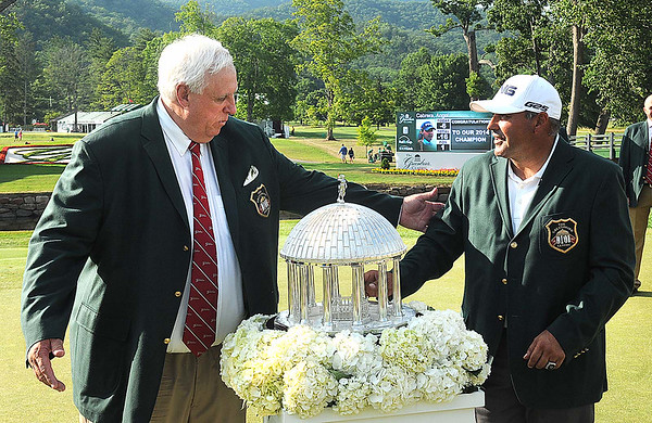 Jim Justice, owner The Greenbrier, presented Angel Cabrera with a green jacket after winning The Greenbrier Classic.<br /> Rick Barbero/The Register-Herald