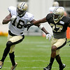 Defensive back Terrence Frederick, right, and receiver Brandon Coleman battle through special teams drills during Saints training camp July 27 in White Sulphur Springs.<br /> Brad Davis/The Register-Herald