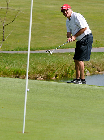 Daniels resident John Scott putts on #2 during the second day of BNI tournament action Sunday morning at Grandview Country Club.<br /> Brad Davis/The Register-Herald