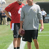 Sean Payton, head coach New Orleans Saints, right, and Ryan Griffin, share a few laughs during the first day of training camp on the new practice fields at The Greenbrier Resort.<br /> Rick Barbero/The Register-Herald