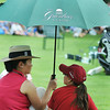 Yolanda Tam, left, and 9-year-old daughter Marley Fredeking, right , take in the youth Day Clinic on Tuesday at the Greenbrier Classic in White Sulpher Springs. F. Brian Ferguson/The Register-Herald