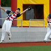 West Virginia infielder Mike Brosseau makes a catch by the wall in foul territory as teammate Rob Youngblood tries to stay out of his way against the Butler BlueSox July 15 at Linda K. Epling Stadium.<br /> Brad Davis/The Register-Herald
