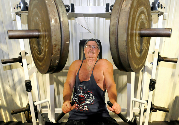 77-year-old Beckley resident Tom Rapp pumps 180 pounds of iron on a Cybex chest machine Monday morning at L.A. East Fitness. The ageless Rapp works out at the Appalachian Drive location four times a week and is usually joined by others his age.<br /> Brad Davis/The Register-Herald