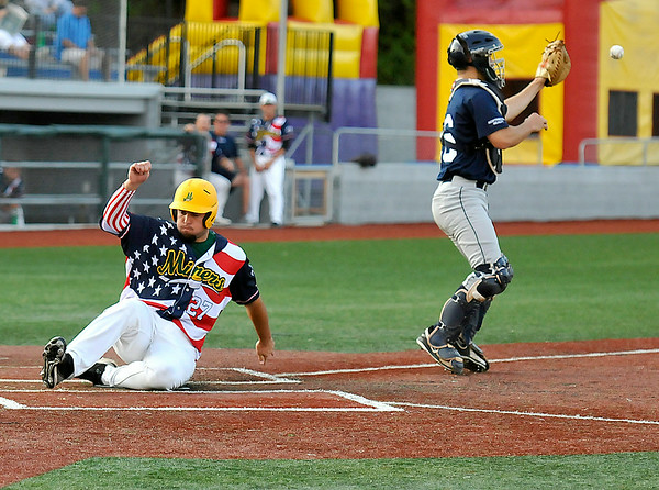 West Virginia's Read Brown slides home to score as the throw to Butler catcher Jeffrey Revesz comes in way too late Tuesday night at Linda K. Epling Stadium.<br /> Brad Davis/The Register-Herald