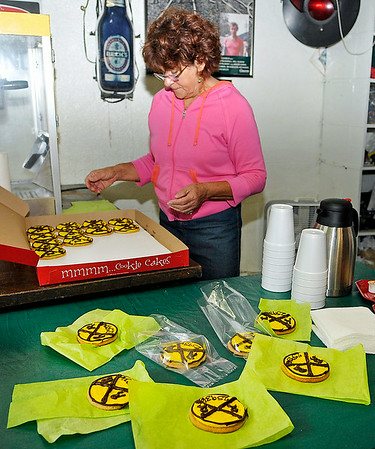 Thurmond resident Caron Ewing sets out free cookies decorated like railroad signs in the old post office of the former Fayette county boomtown Saturday morning.<br /> Brad Davis/The Register-Herald