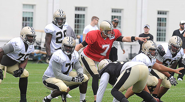 Luke McCown, 7, lines up his offense durin the New Orleans Saints fourth day of training camp on the new practice fields at The Greenbrier Resort.<br /> Rick Barbero/The Register-Herald