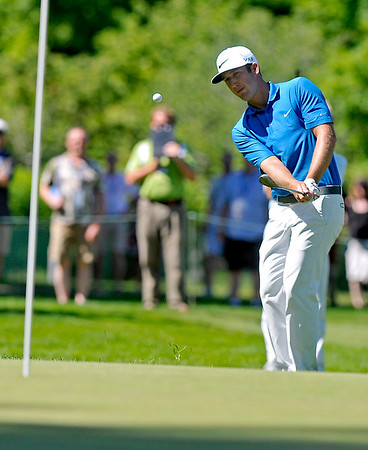 Kevin Chappell chips onto the green on 11 during the Greenbrier Classic Saturday in White Sulphur Springs.<br /> Brad Davis/The Register-Herald