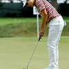 Sang-Moon Bae putts on 15 during the final round of the Greenbrier Classic Sunday in White Sulphur Springs.<br /> Brad Davis/The Register-Herald