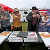 The Hatfields, right, and the McCoys, left, of Theatre West Virginia duke it out yet again, this time in a pizza eating contest during the 11th Annual Friends of Coal Auto Fair Saturday afternoon the YMCA Paul Cline Memorial Youth Sports Complex.<br /> Brad Davis/The Register-Herald
