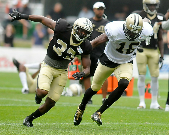 Defensive back Terrence Frederick and receiver Brandon Coleman battle through special teams drills during Saints training camp July 27 in White Sulphur Springs.<br /> Brad Davis/The Register-Herald