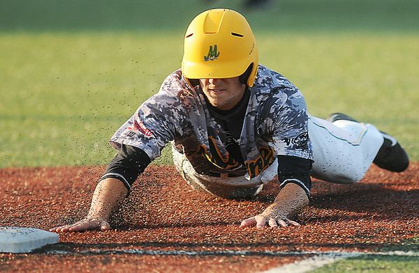 West Virginia Miners Ryan Perkins dives back into first base during Friday evening action at Linda K. Epling Stadium. F. Brian Ferguson/The Register-Herald