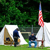 Union infantrymen Dale Lester (left), of Gilbert, and Charlie Stewart, of Lynco, are stationed at their encampment Sunday afternoon at the Oceana Middle School football field. The North and South fought again as re-enactors depicted the skirmish at Methany Chapel, the only Civil War action seen in Wyoming County.<br /> Brad Davis/The Register-Herald