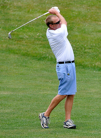 Beckley resident Tim Erwin shoots from the fairway on #16 during the second day of BNI tournament action Sunday afternoon at Brier Patch Golf Course.<br /> Brad Davis/The Register-Herald