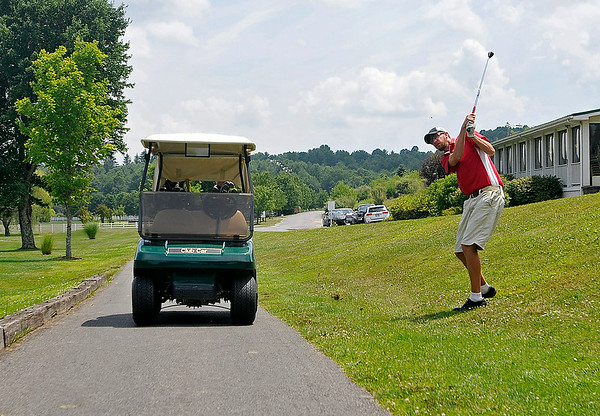 Like his father earlier on the 16th hole, Oak Hill resident Randal Rosiek Jr. finds himself shooting from a strange situation of his own on #18 during the second day of BNI tournament action Sunday afternoon at Brier Patch Golf Course.<br /> Brad Davis/The Register-Herald