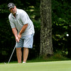 Jeff Hughes chips onto the green on the 16th hole at Grandview Country Club Saturday morning during the 34th annual BNI tournament.<br /> Brad Davis/The Register-Herald