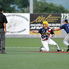 West Virginia's Paul TrenHaile appeals for a baserunner interference call after tripping over a Butler during a game against BlueSox July 15 at Linda K. Epling Stadium.<br /> Brad Davis/The Register-Herald
