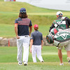 Richard Lee, left, walks to the 18th green with his cadddy during the second round of The Greenbrier Classic.<br /> Rick Barbero/The Register-Herald