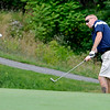 Shady Spring resident Eric Bishop chips onto the green at Grandview Country Club Saturday morning during the 34th annual BNI tournament.<br /> Brad Davis/The Register-Herald