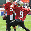 Drew Brees, right and Logan Kilgore going through drills during the first day of training camp on the new practice fields at The Greenbrier Resort.<br /> Rick Barbero/The Register-Herald