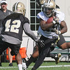 Khiry Robinson, right, tries to break away from Pierre Warren, during the New Orlean's Saints first day of training camp on the new practice fields at The Greenbrier Resort.<br /> Rick Barbero/The Register-Herald