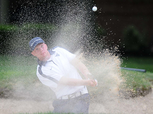Drew Green chips out of the trap on the 12th hole during the BNI on the Cobb course at Glade Springs.<br /> Rick Barbero/The Register-Herald