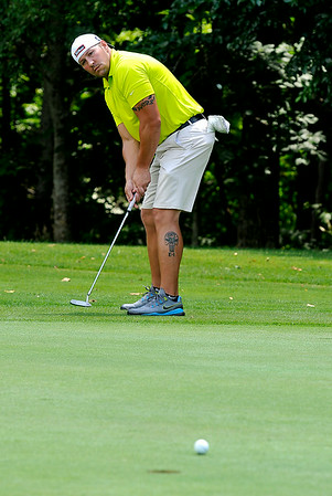 Carthage, New York resident Shane Smith watches his putt from the edge of the green on the 13th hole at the Grandview Country Club Saturday morning during the 34th annual BNI tournament. Smith sank the long putt.<br /> Brad Davis/The Register-Herald
