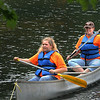 Girl Scouts Alexis Moss, left, and Debra Lively, right, enjoy a canoe ride on Wednesday at Little Beaver Lake. Girl Scouts from all Raleigh County Troops enjoyed an organized day of fishing, hiking,  and cooking out. F. Brian Ferguson/The Register-Herald