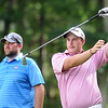 Brandon Waters, left, watches Davey Jude hit his tee shot on the 14th hole hole during the BNI on the Cobb course at Glade Springs.<br /> Rick Barbero/The Register-Herald