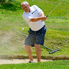 Anstead resident Chuck Hurley chips from a bunker on #2 during the second day of BNI tournament action Sunday afternoon at Brier Patch Golf Course.<br /> Brad Davis/The Register-Herald