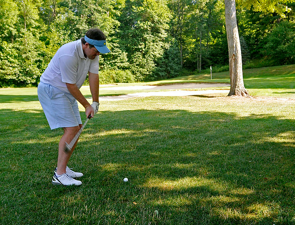 Mullens resident Jonathan Forren shoots from the fairway on the 10th hole at the Brier Patch Golf Course Saturday morning during the 34th annual BNI tournament.<br /> Brad Davis/The Register-Herald