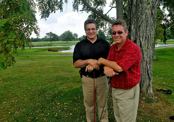 Beckley Register-Herald photographer Rick Barbero, right, poses for a quick photo with his brother David Saturday afternoon at Grandview Country Club following their round in the BNI Tournament. David, playing in the annual event for the 13th straight year, travels 526 miles from Rochester, New York.<br /> Brad Davis/The Register-Herald