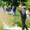 Will Wilcox shoots from a bunker during the Greenbrier Classic Friday in White Sulphur Springs.<br /> Brad Davis/The Register-Herald