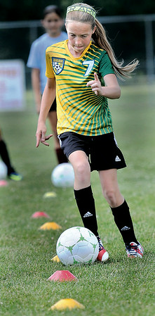 Hattie Hall, 12. shows off her soccer skills during Thursday's YMCA Youth Soccer Camp at the YMCA/ Paul Cline Youth Soccer Complex. The Camp drew almost 100 area youths for the week-long session which will conclude on Friday. F. Brian Ferguson/The Register-Herald