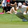 Ben Curtis eyeballs his next putt during the Greenbrier Classic Friday in White Sulphur Springs.<br /> Brad Davis/The Register-Herald