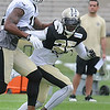 Rafael Bush, right, defends against, Marques Colston during the New Orleans Saints fourth day of training camp at The Greenbrier Resort.<br /> Rick Barbero/The Register-Herald