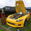 Shady Spring resident Josh Lester's 2001 Honda S2000 Turbo sits on display with the trophies it collected over a couple days at the fair, the small one from Friday night uptown and the much larger one from Saturday. It's got about 98,000 miles on the body and 5,000 on the engine, a 2.0 four cylinder that generates 442 horsepower. <br /> Brad Davis/The Register-Herald